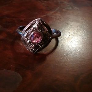 Diamond shaped ring with a pink center